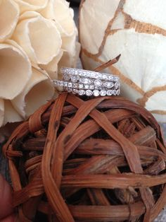 Love the idea of stacking your wedding band with a unique style band for each child.