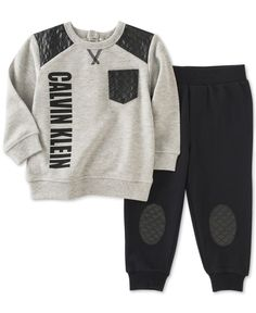 Go for comfy and cute style with a touch of sleek edge-Calvin Klein's adorable sweatshirt-and-jogger-pants set is finished with fun faux-leather details. | Top and pants: cotton/polyester; manmade fau