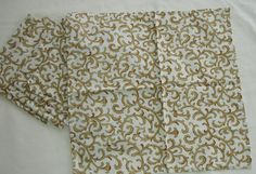 Gold fabric napkins. LK