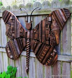 Giant Wooden Picture Frame Molding Butterfly | Lucy Designs ~ Awesome work and Love the creative use of odds and ends... Bits and pieces of this and that, that many would discard or throw away. It takes pure God given talent to see the vision of the hidden potential.
