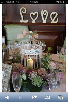 Centre pieces birdcages and flowers