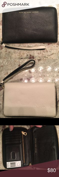 Black and white Marc Jacobs wrist wallet Beautiful Marc Jacobs wrist wallet!    Never been used... Marc Jacobs Bags Clutches & Wristlets