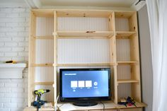 Built In Shelves adding the shelves