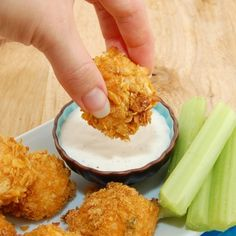 baked buffalo Chicken bites::  What you need:  3 cups shredded cooked chicken  1/4 to 1/2 cup hot sauce (to taste)  3 1/2 ounces cream cheese, softened  1 3/4 cups sharp shredded cheddar cheese  1/4 cup chopped green onions  1 cup all-purpose flour  4 eggs, lightly beaten  3 – 4 cups Corn Flakes cereal, crushed