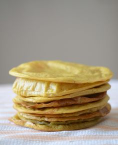 These paleo plantain tortillas are soft, chewy, and mildly sweet. They are wonderful stuffed with beef, avocado, and a zippy garnish of lime and cabbage.