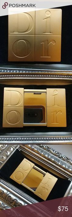 New Christian Dior Compact Mirror w/Velvet Case New Dior slide open purse compact mirror made of solid metal. Slides open & closed. Comes with a pretty solid black velvet Christian Dior traveling/protective case. Compact is a classy Brushed Gold Color with D - I - O - R pressed/stamped into the metal on the front. Black Velvet case VERY WELL MADE!! I only have ONE OF THESE LEFT!! **Price is FIRM Unless Bundled** Christian Dior Makeup Brushes & Tools