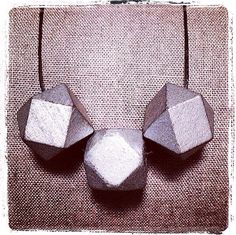 All Wood Silver Painted Polyhedron Necklace with black waxed linen cord. On 32 cord. Rests 16 on chest.