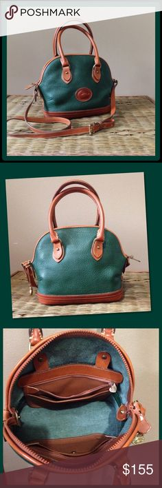 """⚡️FLASH SALE⚡️Dooney & Bourke Norfolk Satchel Hunter green leather with tan trim and gold hardware. Zip closure. Interior has removable pockets on both sides. Crossbody adjustable strap is removable with a strap drop of 16-20"""". Handle drop is 5"""". Duck hang fob. Excellent used condition! Does not even look vintage! No stains or rips. Leather is in great condition too! Was $110. Dooney & Bourke Bags Satchels"""