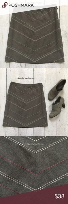 """Ann Taylor gray skirt with diagonal stitching Mint condition Ann Taylor charcoal gray skirt with plum and ivory chevron stitch detail on front and back. Size 4P but can also work for 4 regular. Approx 19"""" long, 14"""" across waist. Shoe boots not for sale. Please read updated bio regarding closet policies prior to any inquiries. Ann Taylor Skirts"""