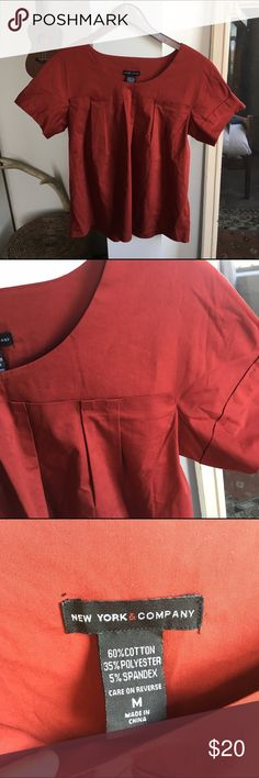 Structured Top in Rust Color--NY & Co Amazing top! In like new condition. This is reminiscent of the brand COS. Perfect for autumn! 🍁🍂 No trades. 💕 New York & Company Tops Blouses