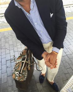 Navy blazer, white shirt with light blue candy stripes, khakis