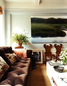 thinking about the dark sofa, light walls. great art, Markham Roberts