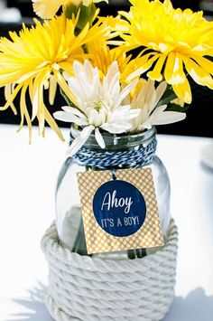 Floral centerpiece at a nautical baby shower party! See more party planning ideas at CatchMyParty.com!