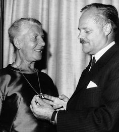 Austrian Minister of Education Theodor Piffl-Percevic presents Maria Trapp the Honorary Cross for Science and Art First Class for fostering cultural relations between the U.S. and Austria, New York, August 31, 1967.  (AP Photo)