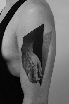 Dotwork hand tattoo on the left upper arm, inspired by Michelangelo's David.