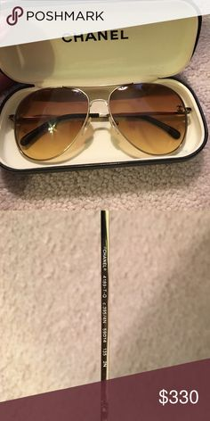 Authentic Chanel sunglasses Chanel aviator sunglasses. Classic Chanel logo on front of lens. Gold frames. Gold lenses. Minor scratches on lens CHANEL Accessories Sunglasses