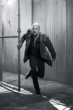 On the move, Common wears a Burberry leather trench coat with a Michael Kors polo. Common also rocks Theory pants and Noah Waxman sneakers.