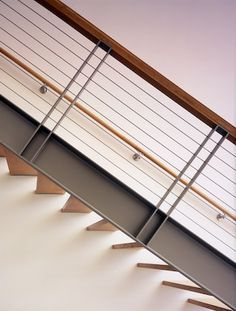 interior under floating stair material commercial river rock - Google Search