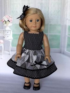 18 inch doll dress and hair clip. Fits American Girl Dolls. Black and white double ruffled dress.