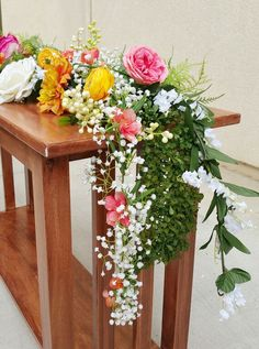 DIY Flower Garland.  This beautiful DIY flower garland is simple to make with this easy how to make a floral garland video.  Use as a floral table runner at your wedding or to decorate a mantel in your home.  Mix and match your favorite Afloral.com silk flowers and garland for a one of a kind creation.