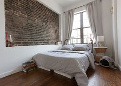 Bedroom with exposed brick wall | Gravity Home
