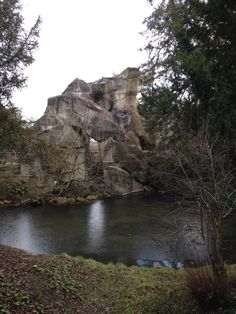 "The queen's grotto. This rock formation was made of quarried stone. During the summer months Marie Antoinette would hold private fetes here with ""swimming"" and dinners.   The faux stone outcropping has water that spills from both sides of it."
