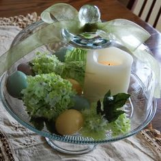 Use the green glass cake stand as a base for this Easter centerpiece.