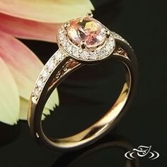 Custom 14kt rose gold halo style mounting with pink sapphire center stone and bead set diamonds in halo and top face of engagement ring. Slight scalloped pattern under head and curling filigree in side face panels under head. - See more at: http://www.greenlakejewelry.com/gallery/cust_gallery.aspx?ImageID=71623#sthash.hEVIHzJF.dpuf