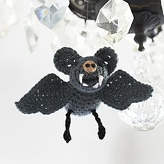 Crochet this bat (or a bunch) to hang outside for Trick or Treaters. Try it out in Vanna's Choice. Pattern by Nicki Tench.