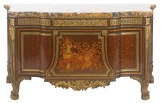 A Louis XVI style gilt bronze-mounted fruitwood parquetry and marquetry commode à vantaux Paris, late 19th Century, after the model by Jean-Henri Riesener