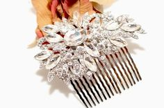 Bella-Tiara Bold Statement Crystal Hair Comb. Bella-Tiara Bold Statement Crystal Hair Comb on Tradesy Weddings (formerly Recycled Bride), the world's largest wedding marketplace. Price $29.99...Could You Get it For Less? Click Now to Find Out!