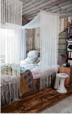 Put some fake flower petals or something over top of canopy. Love the curtain idea above the bed, but I would not use white.