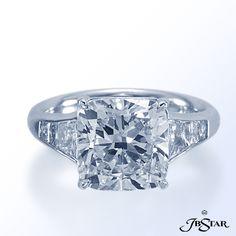JB Star cushion cut diamond with trapezoids and princess diamonds.