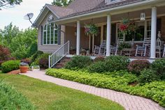 Curb appeal: Landscaping to House front porch garden with walkway path, hanging plants, shrubs and groundcovers, lawn grass