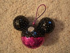 "sequined mickey ornament ""Its three styrofoam balls glued together, and the sequins are put in one by one with sequin pins."" -SewIn2Disney"