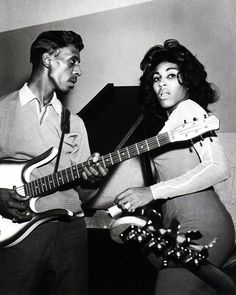 Ike (with a Danelectro guitar) and Tina Turner. Photo by Gilles Petard / Redferns). January 1, 1963. °