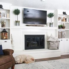 This room is asymmetrical. Neither TV nor fireplace are in the middle.This room is asymmetrical. Neither TV nor fireplace are in the middle.(no title) Hottest Totally Free Electric Fireplace Ideas Suggestions Everyone Loves A Fire Built In Around Fireplace, Tv Over Fireplace, Family Room Fireplace, Fireplace Shelves, Fireplace Built Ins, White Fireplace, Fireplace Remodel, Farmhouse Fireplace, Fireplace Design