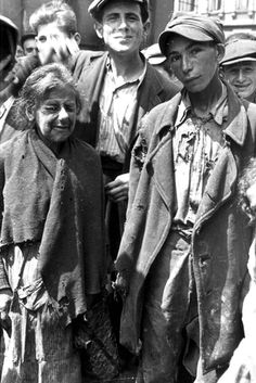 Warsaw, Poland, Jews in a ghetto street.  One of the photographs taken by the German photographer Willi George over the course of a single day in the summer of 1941. The photographs are unique in that they were not staged, but showed the ghetto as it truly was.