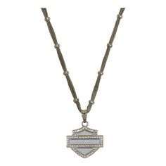 This necklace features a rhinestone outline of the classic Harley-Davidson® bar & shield®. The multi-strand chain has metal beads anchored along its length.