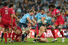 Michael Hooper of the Waratahs is tackled during the round 20 Super Rugby match between the Waratahs and the Reds at ANZ Stadium on July 13, 2013 in Sydney, Australia.