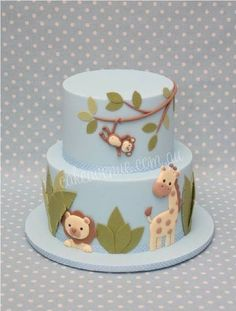baby blue with baby animals.  Baby shower cake.