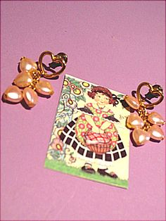 """Open gold tone heart ear post.  Small pearl-like hearts dangle.  Each heart is 1/4"""".  (Have one pair of earrings.  Price is $2.99.)"""