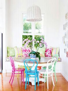 Love the table and different colored chairs. I think I'd rather have a square or rectangle table though.