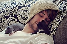 A hot guy and two kittens....oh yeah!