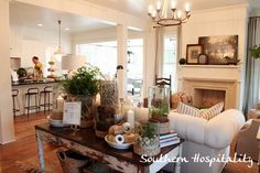 Really love this mantle arrangement.  via Southern Living Idea house living room