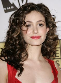 Emmy Rossum - good length and shows how layers around face with curly hair could look.
