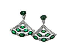 Bulgari High Jewellery emerald earrings in platinum featuring 14 oval-shaped Zambian emeralds, pear-shaped diamonds, round brilliant-cut diamonds and pavé diamonds.