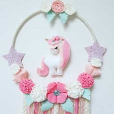 Unicorn Dream Catcher In Pinks, cream and mint  #unicorn #unicorndecor #iloveunicorns #unicornlover #girlsdecor #dreamcatcher #dreamcatchers #feltflowers #felt #australianhandmade #etsyau #feltflowers #girlsdecor #girlsroom #babyshowergift #nursery #girlsroomdecor #kidsdecor #fortheloveofaustralianhandmade