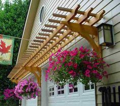 Hanging baskets dress up a garage arbor.