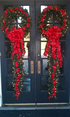 Holiday Wreaths and Swags. A great twist on the traditional wreath or swag door arrangement. I really like this idea. I've seen so many great door decorating ideas. I think these will look great on the atrium doors to the deck.